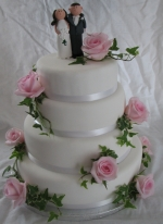 Fondant iced pink roses and figurines