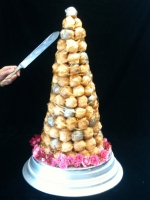 sword cutting croquembouche french wedding cake