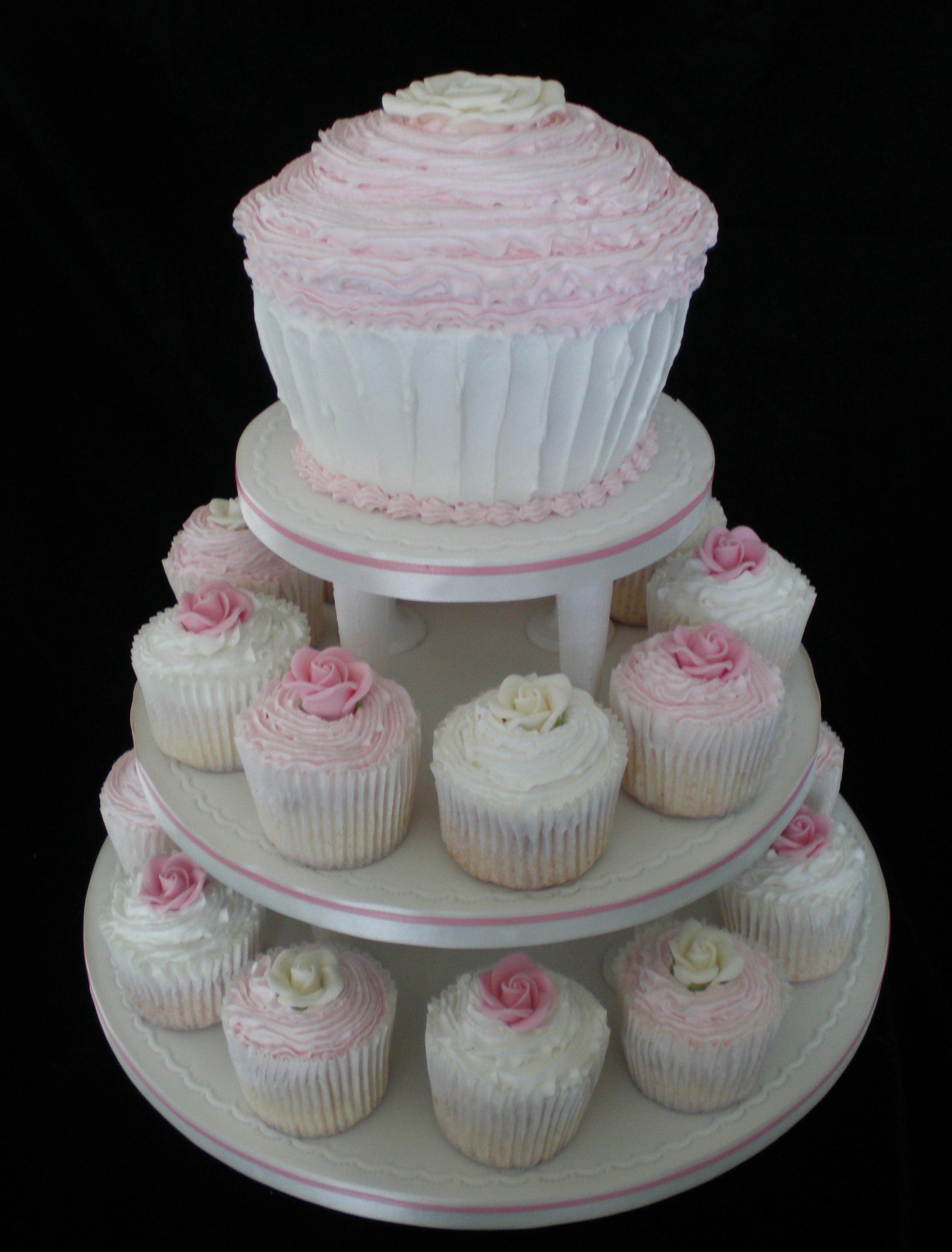 giant cupcake and mini cupcakes wedding cake