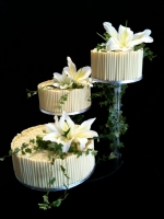 white chocolate scrolls and curls wedding cake with white lilies