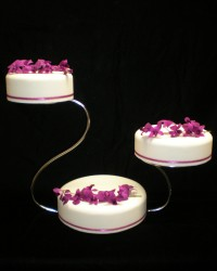 orchid cascade cake on swan stand