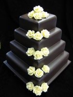 chocolate ganache glazed cake with white chocolate roses